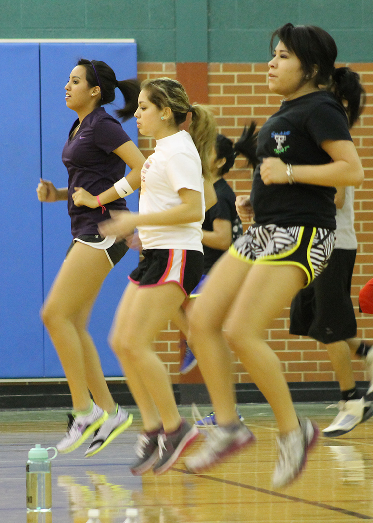 Photo by SELLA ROBINETT  Elise Rodriguez, Abbie Velasquez and Alex Rael, all nursing majors, work out at Badger Fit Night February 4, 2013 at Carter Fitness Center, Washington St Campus.