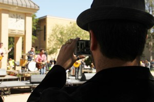 Photo by Heather Hinkle  SGA Vice President Trey Jimenez, a social work and psychology major, takes a picture of the band at Fallfest..