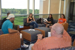 Photo by Emily Prestwood  Legal Society members discuss club business.