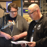 Photo by Amanda Castro-Crist  Tyler Williams, a radio-TV production major, and Brian Frank, FM90 program director, review a playlist at FM90.