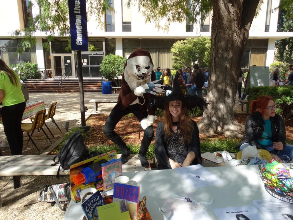 Photo by Victori Amaya Katya Harvey, dressed as Scarecrow from Batman, and Ally Miller, as Hermione Granger  from Harry Potter, pose at the Sigma Kappa Delta table at Fallfest.
