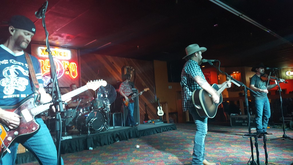 Geoffrey Hill, left, Randy Rogers and Brady Black play one of their many hits at the band's most recent performance at Midnight Rodeo.