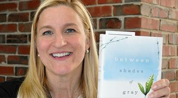 Best-selling author Ruta Sepetys holds Between Shades of Gray, Amarillo College's 2015 Common Reader.