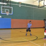 Aro Nebk, a math major, plays basketball with a friend, Ronald Williams, in Carter Fitness Center.