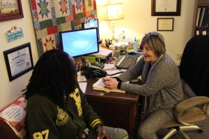 Nacy Brent, coordinator of the Adult Students Program, advises Nashon Steed