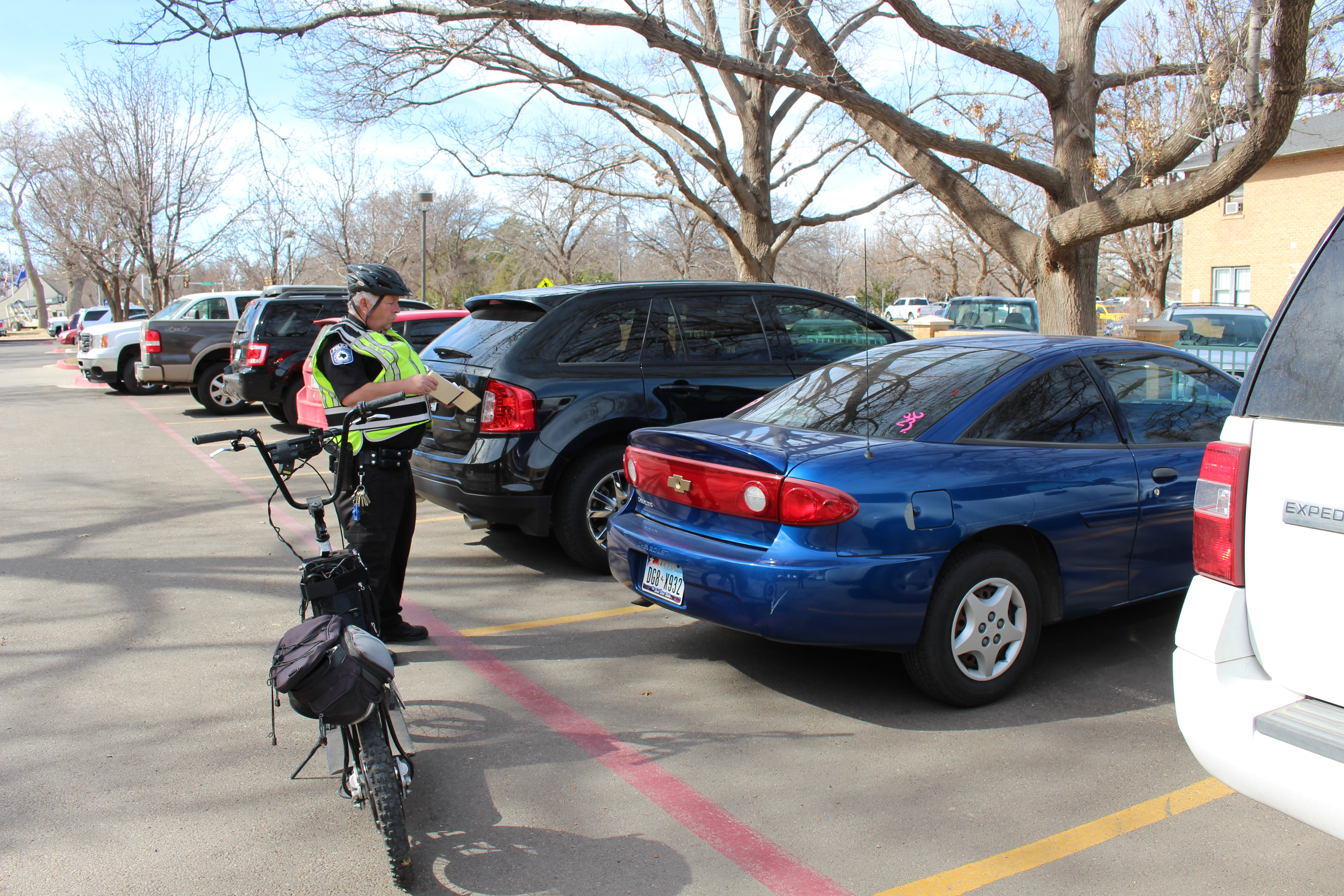 Amarillo College Police Officer Robert Taylor writes out a ticket on the Washington Street Campus.