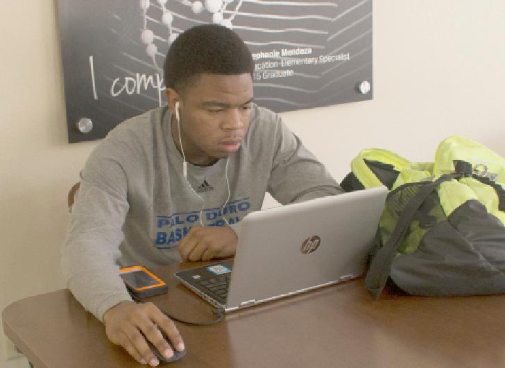 reyna santos | The Ranger Kenbyrei Freeman, a sociology major, uses a laptop to complete schoolwork.