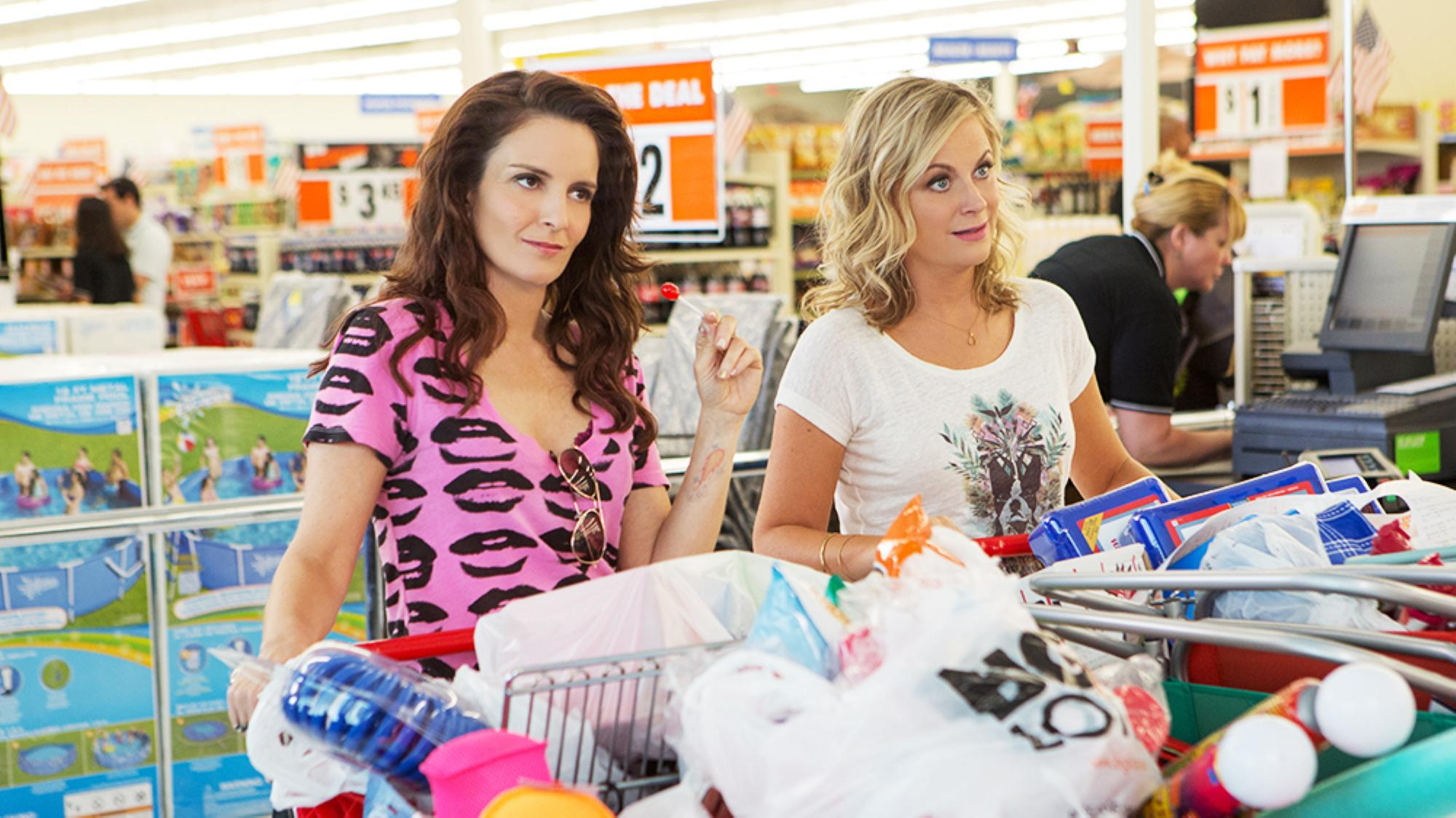 Tina Fey, left, and Amy Poehler play two sisters who decide to throw one last house party before their parents sell their family home in Sisters.