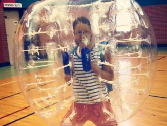 Courtesy photo. Coordinator of New Student Programs Calee Follins was the former intramurals coordinator, which is why she is pictured here in a bubble soccer ball. Trent Oneal will now serve as intramurals coordinator.