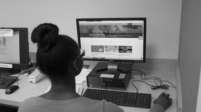 Student looking at the new website.