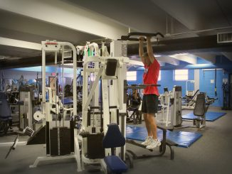 Student Working out at the fitness center