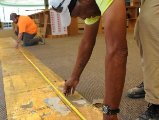 construction worker measuring