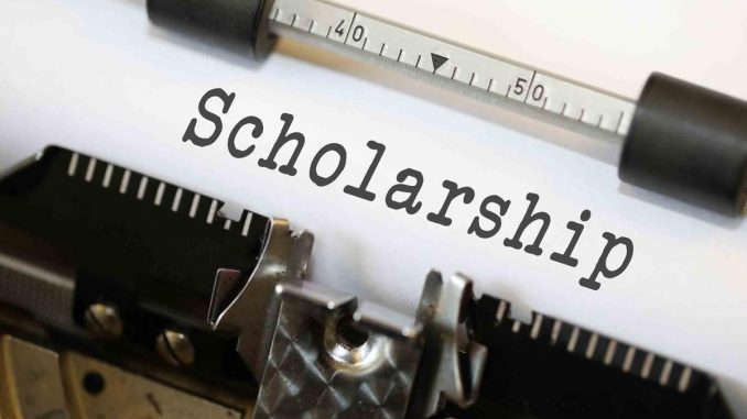 a typewriter is writing the word Scholarship