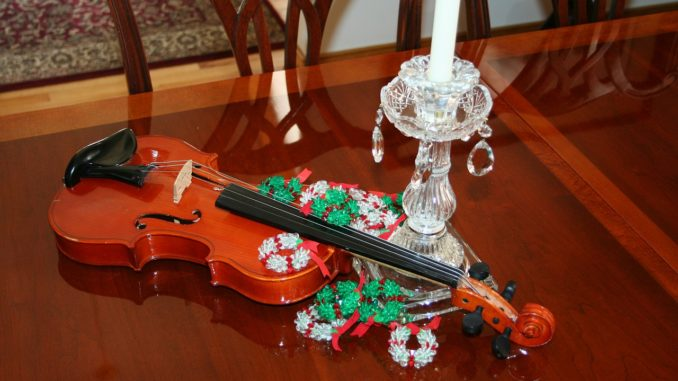 Violin with a candle